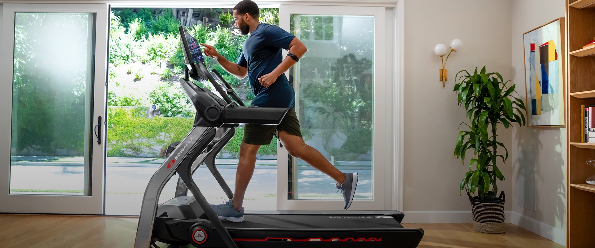 Man using a Bowflex treadmill.