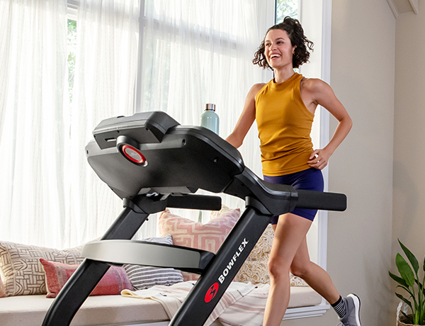 happy woman running on a Treadmill 18