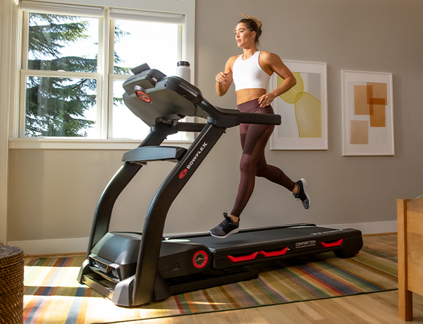 woman running on a BXT116 Treadmill in a house