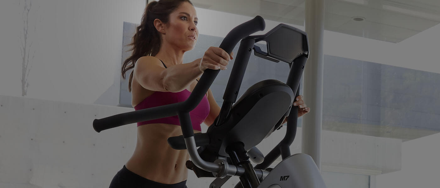 Erin working out on a Max Trainer
