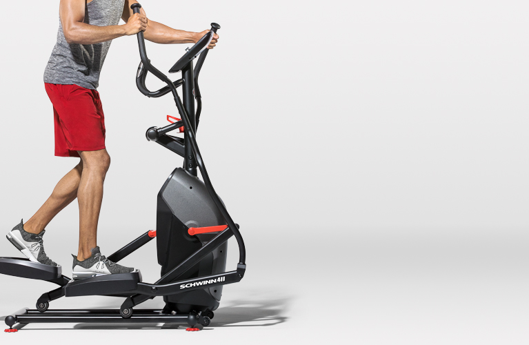 Man working out on a Schwinn elliptical