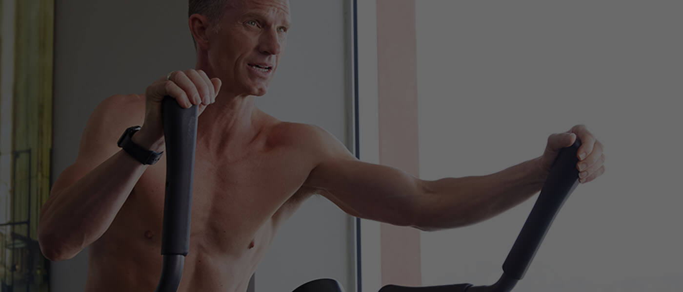 Phil working out on a Max Trainer