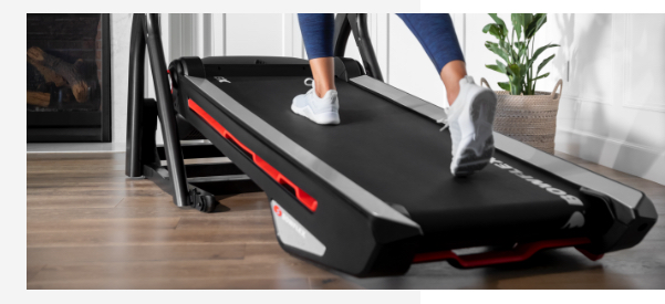 A woman using treadmill with incline