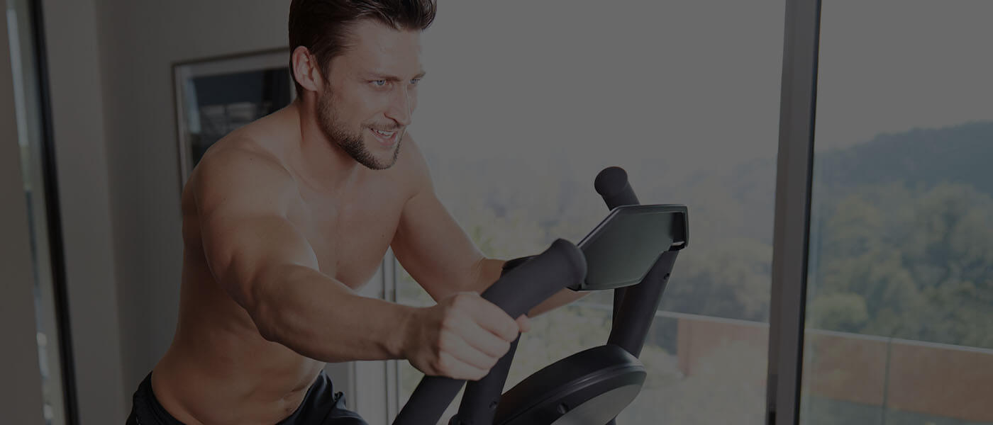 Ryan working out on a Max Trainer