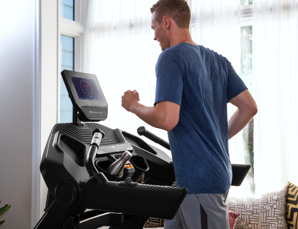 man running on a Treadmill 10 in a house