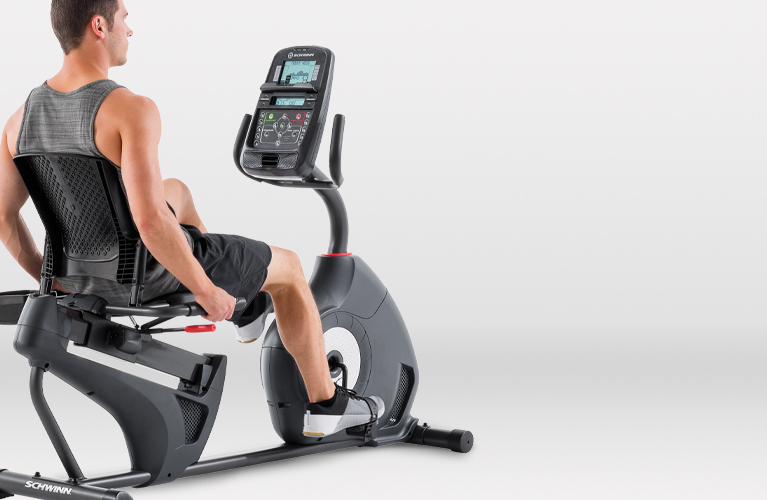 Man working out on a Schwinn recumbent bike