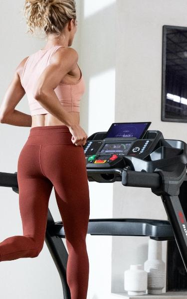 Woman using a Bowflex Treadmill