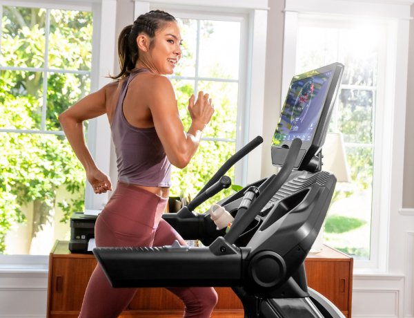 woman running on a Treadmill 56 in a sunny room