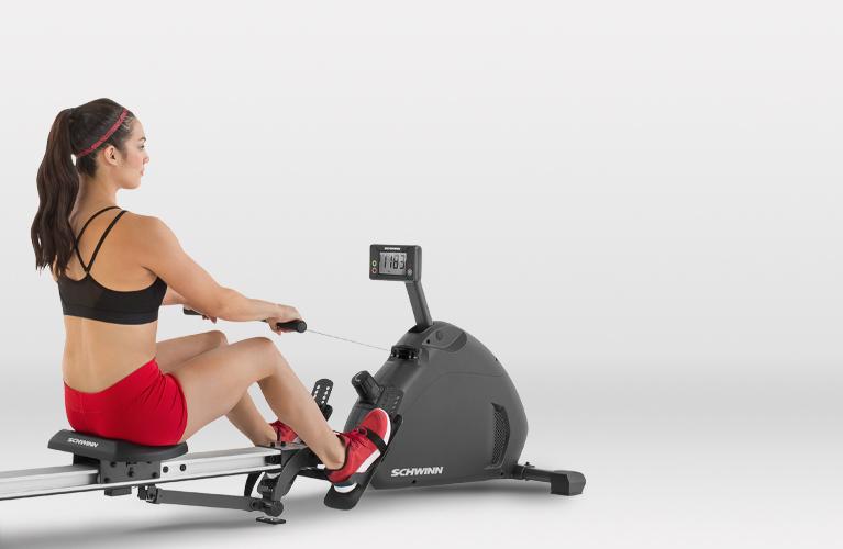 Woman exercising on a Schwinn rower